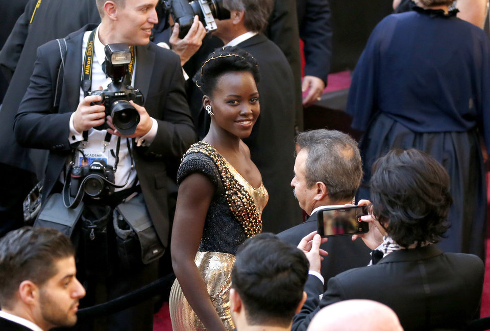 Photo - Lupita Nyong'o arrives at the Oscars on Sunday, March 4, 2018, at the Dolby Theatre in Los Angeles. (Photo by Eric Jamison/Invision/AP)