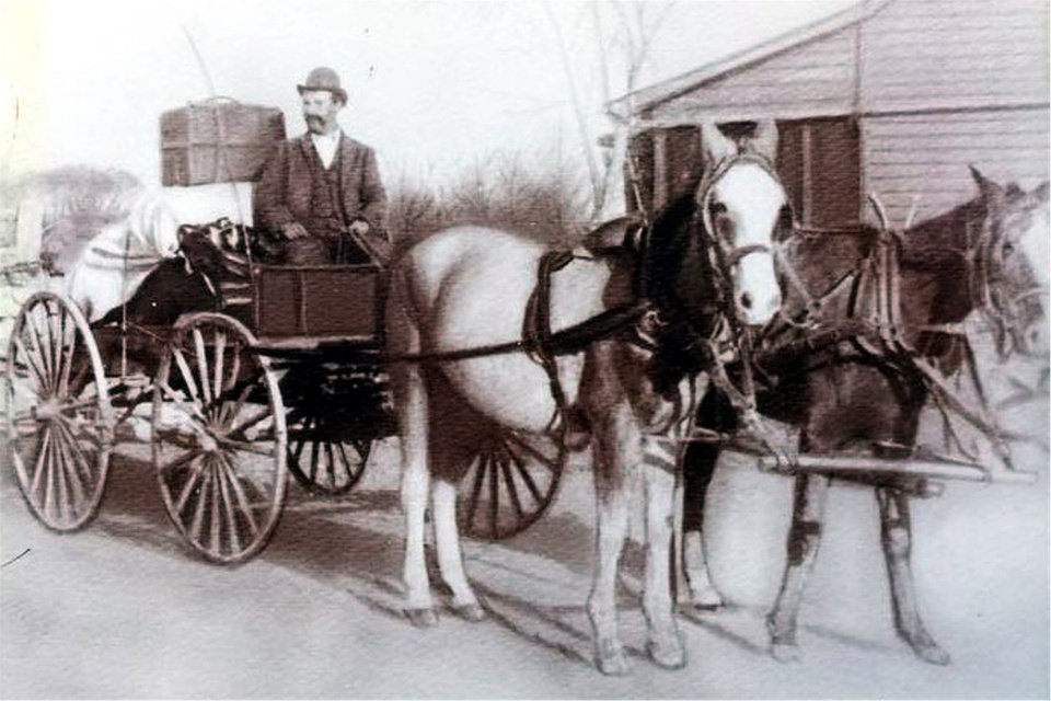 Photo -  Richard Mettry, in his original traveling dry goods store, a buckboard wagon, is shown circa 1903. [Photo provided]