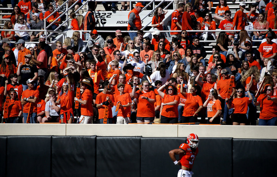 Photo - Fans cheer as Oklahoma State warms up before the college football game between Oklahoma State University and Baylor at Boone Pickens Stadium in Stillwater, Okla., Saturday, Oct. 19, 2019. [Sarah Phipps/The Oklahoman]
