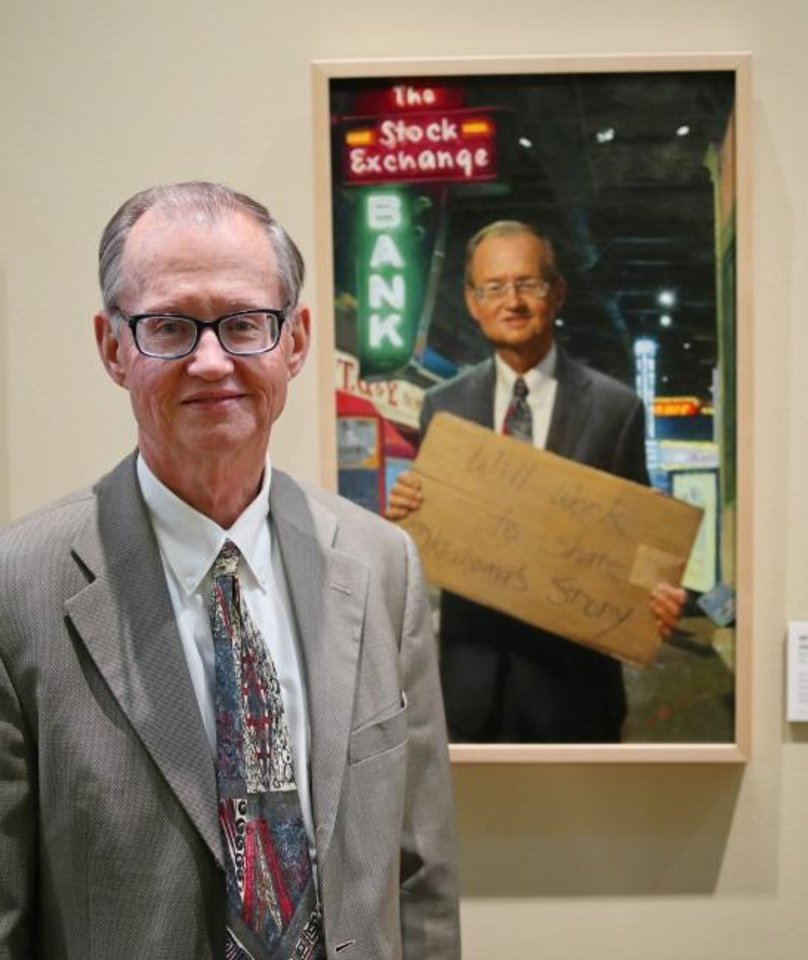 Photo -  Bob Blackburn stands in front of his  portrait by Georgia-based Oklahoma native Mike Wimmer at the Oklahoma History Center on March 21. [Doug Hoke/The Oklahoman]