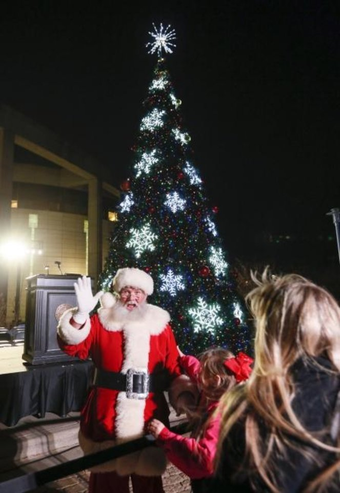 Photo -  Santa Claus waves after the Governor's Christmas Tree Lighting at the Oklahoma History Center in Oklahoma City, Monday, Dec. 9, 2019. [Nate Billings/The Oklahoman]
