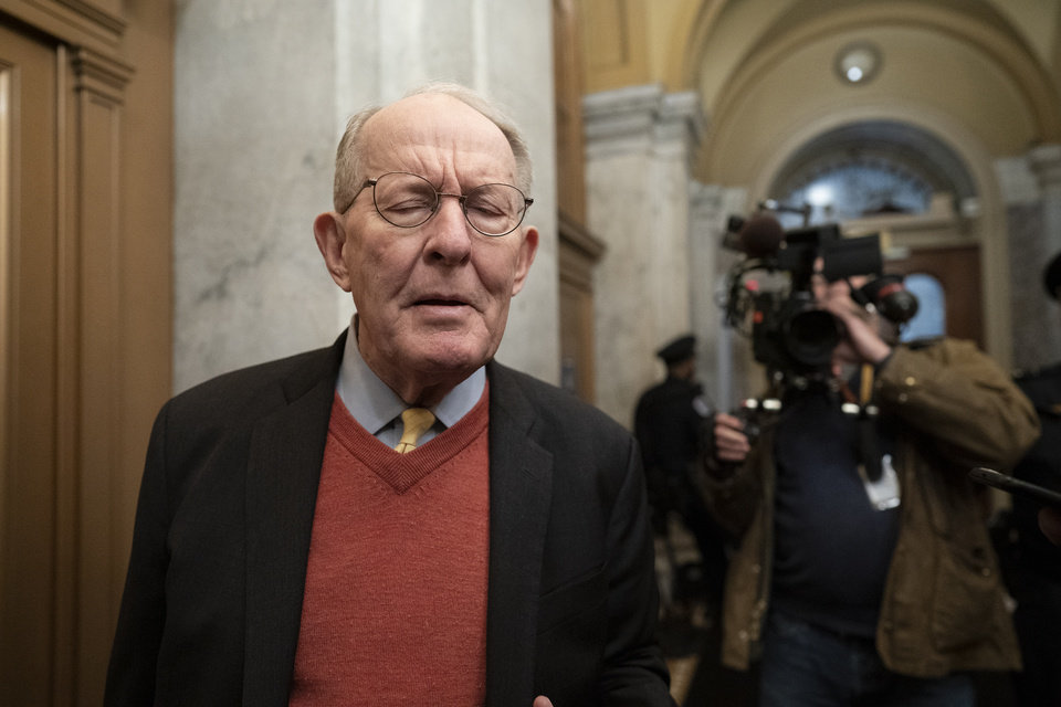 Photo - Republican Sen. Lamar Alexander of Tennessee, talks to reporters as he arrives at the Capitol for the impeachment trial of President Donald Trump on charges of abuse of power and obstruction of Congress, in Washington, Friday, Jan. 31, 2020.  (AP Photo/J. Scott Applewhite)