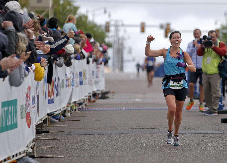 Photo - Maddie Glass finishes the Oklahoma City Memorial Marathon in Oklahoma City, Sunday, April 30, 2017. Photo by Bryan Terry, The Oklahoman