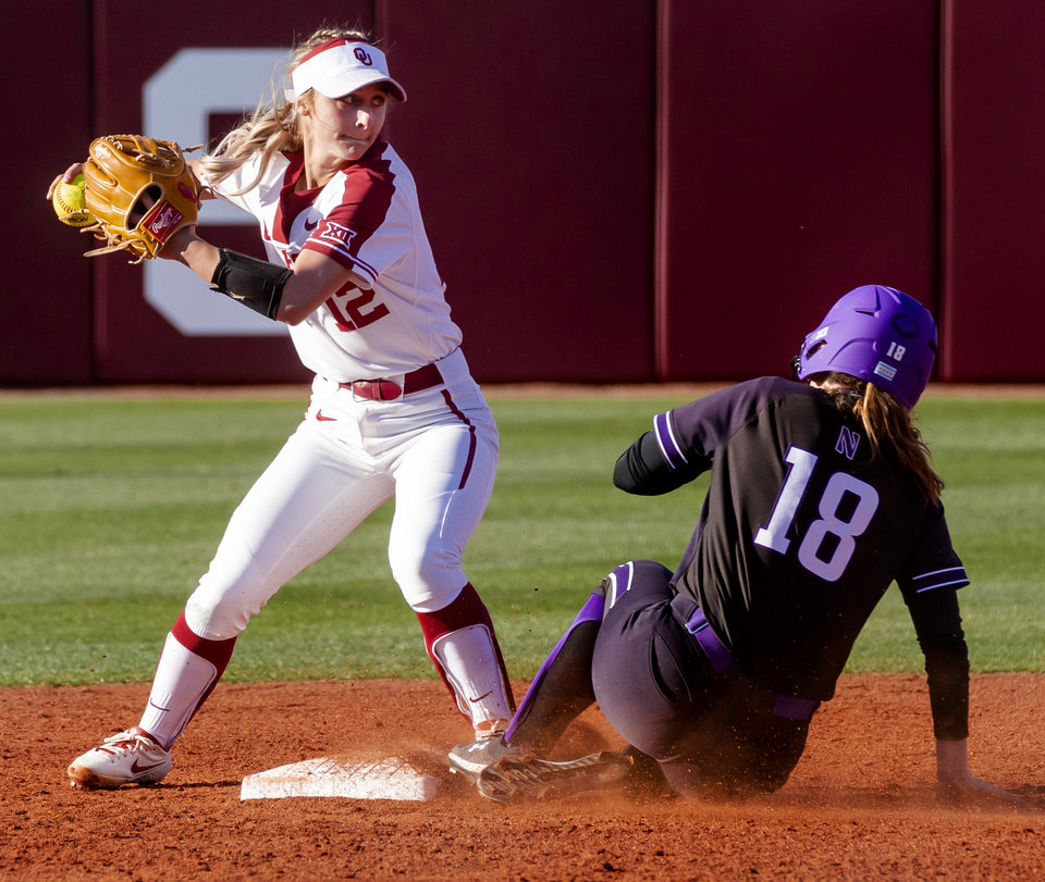 Photo - Oklahoma's Mackenzie Donihoo (12) gets the out at second on Northwestern's Morgan Newport (18) during the college softball game between the University of Oklahoma Sooners (OU) and Northwester University Wildcats (NU) at Marita Hynes Field in Norman, Okla. on Friday, Feb. 28, 2020.    [Chris Landsberger/The Oklahoman]