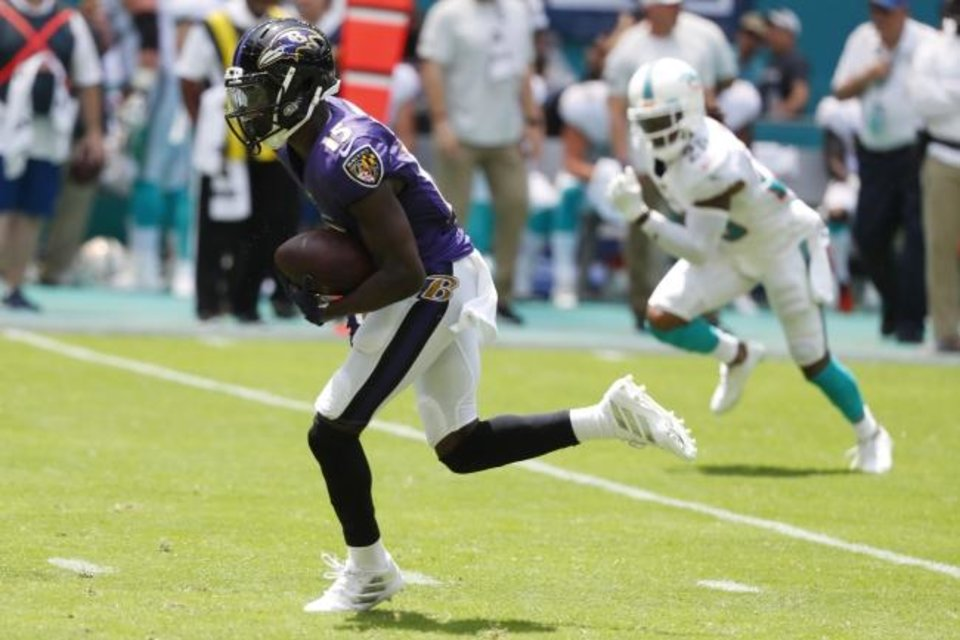Photo -  Former Oklahoma standout and current Baltimore rookie Marquise Brown had the Miami Dolphins playing catch-up Sunday. His first two NFL catches went for touchdowns, punctuating one of the greatest days by a Sooner receiver in the NFL. [AP PHOTO]
