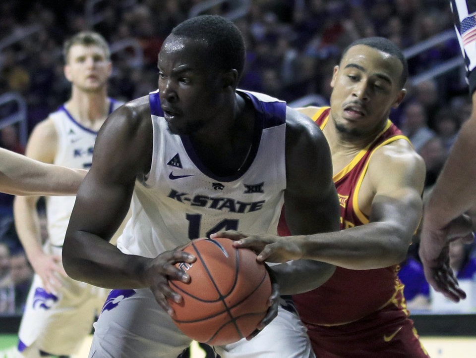 Photo - Iowa State guard Talen Horton-Tucker, right, reaches in against Kansas State forward Makol Mawien (14) during the second half of an NCAA college basketball game in Manhattan, Kan., Saturday, Feb. 16, 2019. (AP Photo/Orlin Wagner)