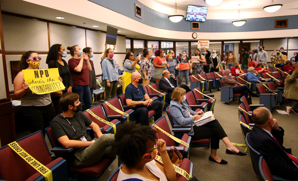 Photo - Black Lives Matter protesters who want to defund the police file into the Norman City Council chambers in Norman, Tuesday, June 9, 2020. [Doug Hoke/The Oklahoman]