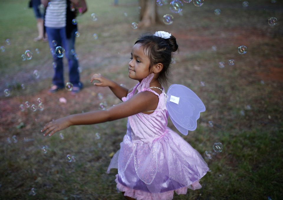 Photo -  Savina George chases bubbles at last year's Fairy Ball at First Christian Church in Oklahoma City. [Photo by Sarah Phipps, The Oklahoman Archives]