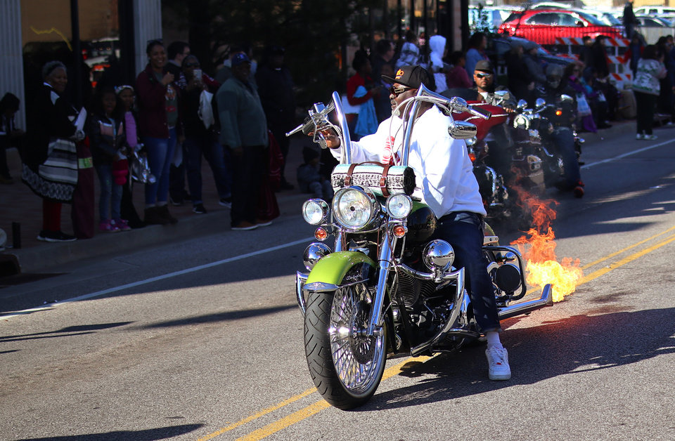 Photo - Motorcyclist ignites flames from his exhaust during celebration of Dr. Martin Luther King, Jr. holiday, Monday, January 20, 2019. [Photo by Doug Hoke/The Oklahoman]