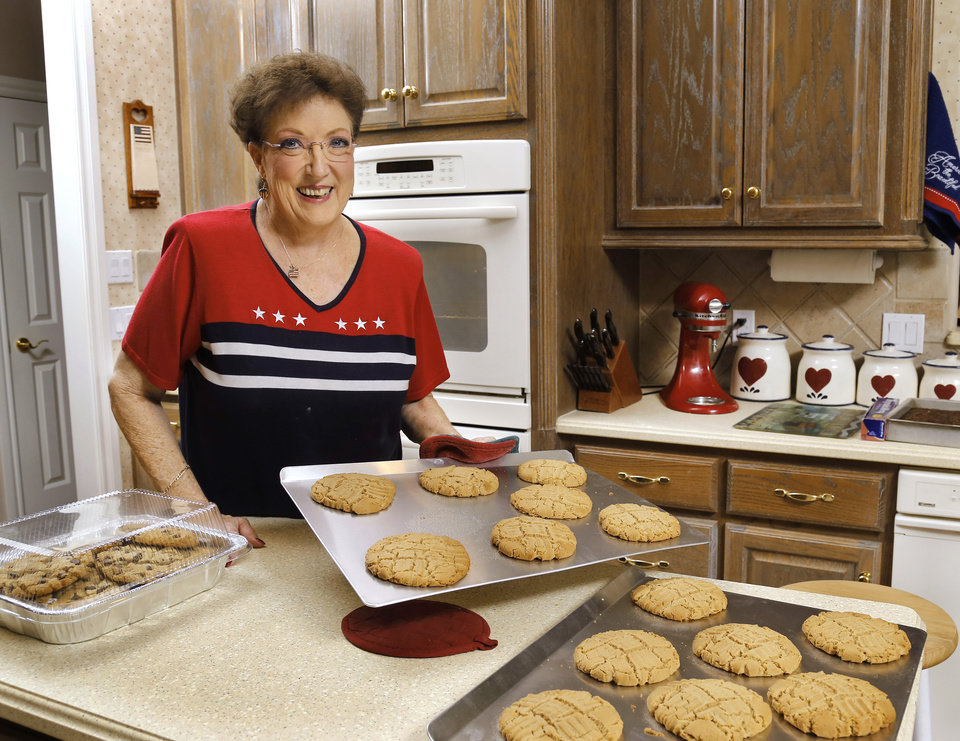 Photo -  Betty Hulson bakes cookies in the kitchen of her Edmond home on a recent Tuesday afternoon. Hulson bakes cookies every week for the YMCA Military Welcome Center at Will Rogers World Airport. [Photo by Jim Beckel, The Oklahoman]