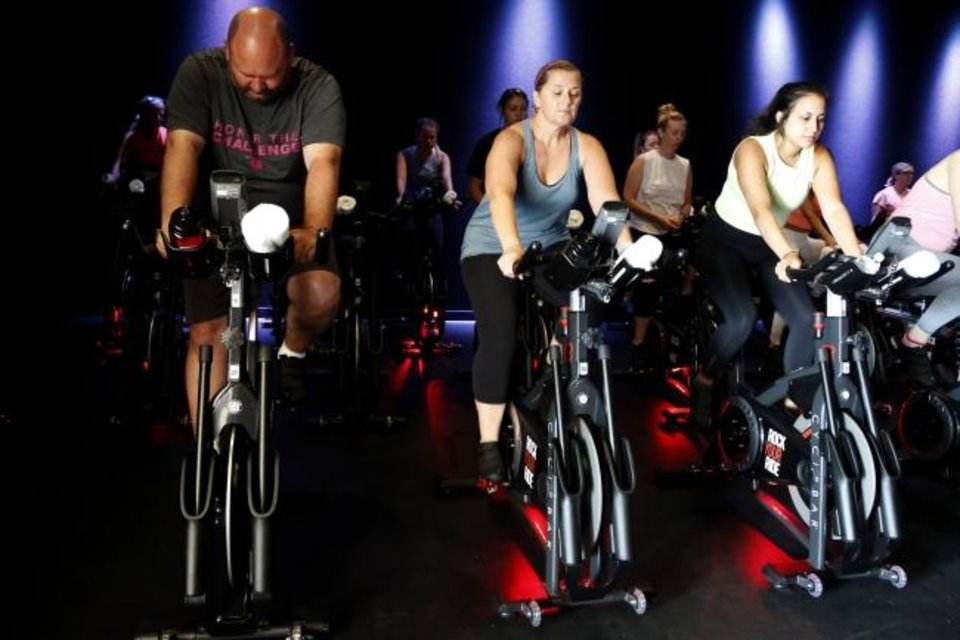 Photo -  Members prepare for the 9:30 a.m. class to start at the new CycleBar studio in Norman Oklahoma on Thursday. [PAXSON HAWS/THE OKLAHOMAN]