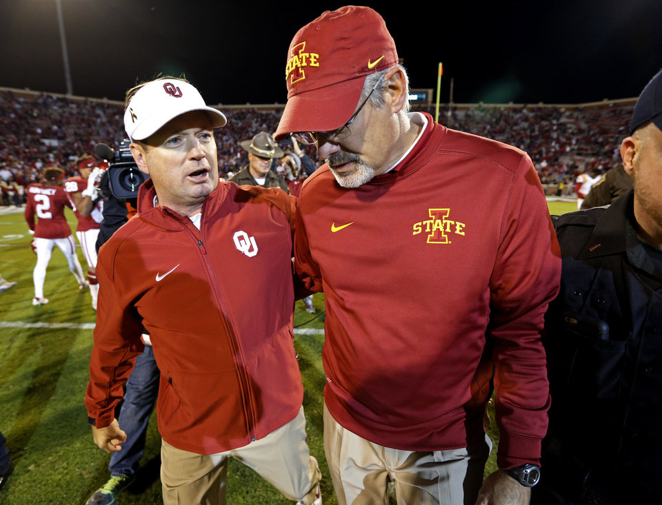 Photo - Oklahoma head coach Bob Stoops and Iowa State head coach Paul Rhoads talks as the leave the field after a college football game between the University of Oklahoma Sooners (OU) and the Iowa State Cyclones at Gaylord Family-Oklahoma Memorial Stadium in Norman, Okla., on Saturday, Nov. 7, 2015. Photo by Steve Sisney, The Oklahoman