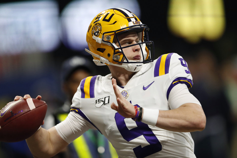 Photo - FILE - In this Dec. 7, 2019, file photo, LSU quarterback Joe Burrow (9) warms up before the Southeastern Conference championship NCAA college football game against Georgia, in Atlanta. Burrow is a unanimous selection as the offensive player of the year on The Associated Press All-Southeastern Conference football team, Monday, Dec. 9, 2019.(AP Photo/John Bazemore, File)