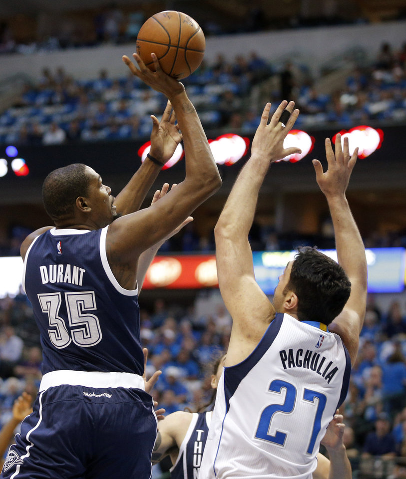 Photo - Oklahoma City's Kevin Durant (35) shoots over Dallas' Zaza Pachulia (27) during Game 3 of the first round series between the Oklahoma City Thunder and the Dallas Mavericks in the NBA playoffs at American Airlines Center in Dallas, Thursday, April 21, 2016. The Thunder won 131-102. Photo by Bryan Terry, The Oklahoman