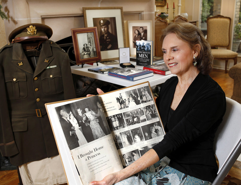 Photo -  Kira Harris Johnson, of Fort Worth, Texas, shares memories Oct. 13 after speaking to a meeting of the Redbud Women's Club in Edmond. Johnson's late father, Maud native Clyde Kenneth Harris, was a Monuments Man during World War II. [Photo by Jim Beckel, The Oklahoman]