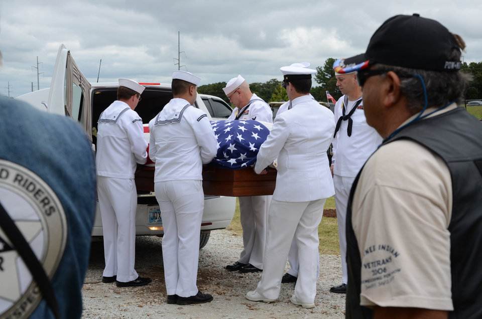 Photo -  After his remains were identified mid-2019, U.S. Navy Fireman 1st Class James Cecil Webb's burial has been a long time coming — nearly 80 years. The 23-year-old Hobard native, along with 428 sailor and Marine shipmates, died at Pearl Harbor on Dec. 7, 1941, when the USS Oklahoma was attacked. Nearly eight decades after that historic day, Webb has finally made it back to Oklahoma. A graveside memorial was held at Dale Cemetery in Central Oklahoma Wednesday to honor the young sailor. [Vicky O. Misa photos/Shawnee News-Star]