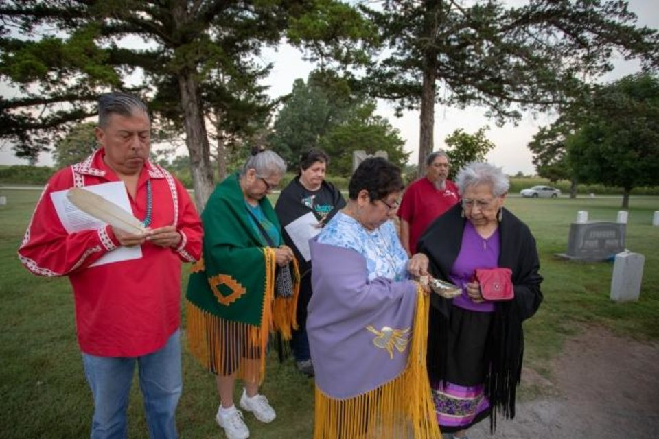 Photo -  The Rev. David Wilson, superintendent of the Oklahoma Indian Missionary Conference, leads a prayer vigil at an Apache POW cemetery at Lawton's Fort Sill. [Ginny Underwood/Oklahoma Indian Missionary Conference]