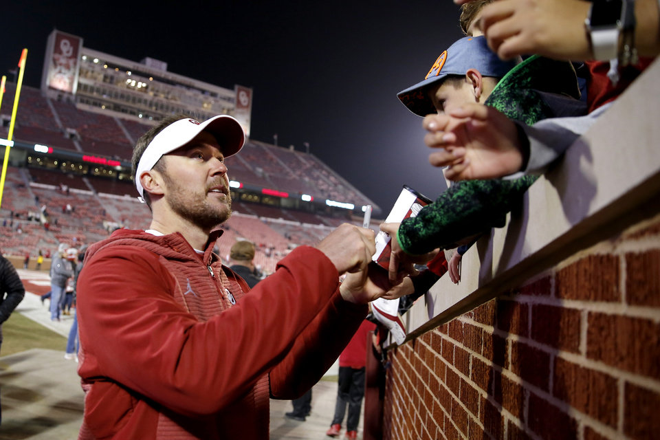 Photo - Oklahoma coach greets fans after a college football game between the University of Oklahoma Sooners (OU) and the Kansas Jayhawks (KU) at Gaylord Family-Oklahoma Memorial Stadium in Norman, Okla., Saturday, Nov. 17, 2018. Photo by Bryan Terry, The Oklahoman