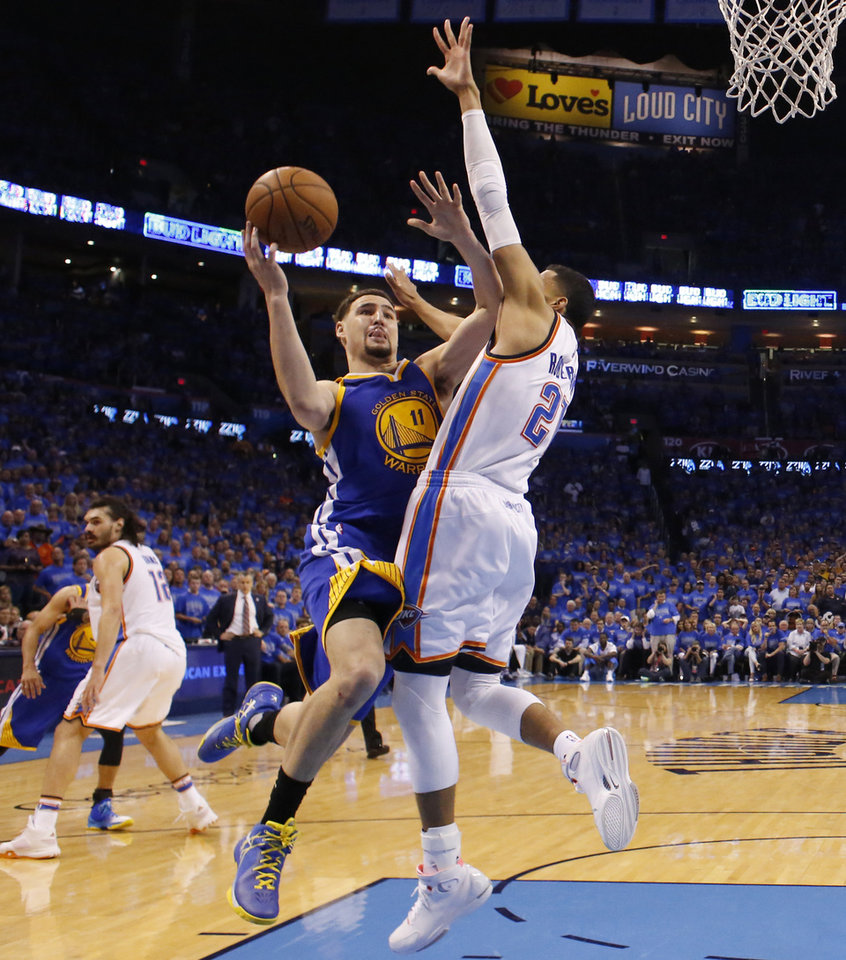 Photo - Golden State's Klay Thompson, left, tries to get past Oklahoma City's Andre Roberson during Game 6 of the Western Conference finals at Chesapeake Energy Arena in Oklahoma City on Saturday. (Photo by Bryan Terry, The Oklahoman)