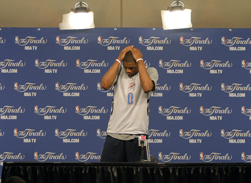 Photo - Oklahoma City's Russell Westbrook prepares to talk to the media during the NBA Finals practice day at the Chesapeake Energy Arena on Monday, June 11, 2012, in Oklahoma City, Okla. Photo by Chris Landsberger, The Oklahoman