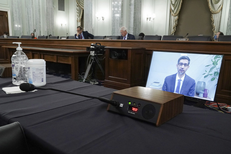 Photo -  FILE - Google's CEO Sundar Pichais appears on a screen as he speaks remotely during a hearing before the Senate Commerce Committee on Capitol Hill, Wednesday, Oct. 28, 2020, in Washington. The committee summoned the CEOs of Twitter, Facebook and Google to testify during the hearing. (Greg Nash/Pool via AP)