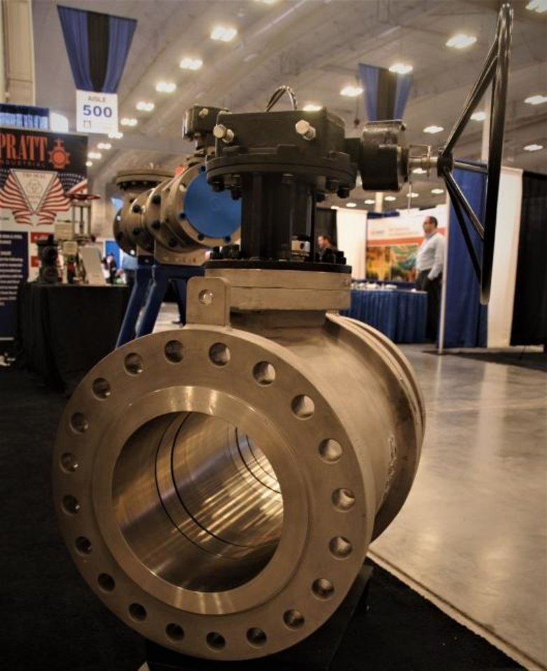 Photo -  A 12-inch, stainless steel valve sold by Microfinish Valves is displayed at the company's exhibit space at the Oil & Gas Expo in Oklahoma City. About 280 companies providing products and services to the oil and gas industry participated in the event.