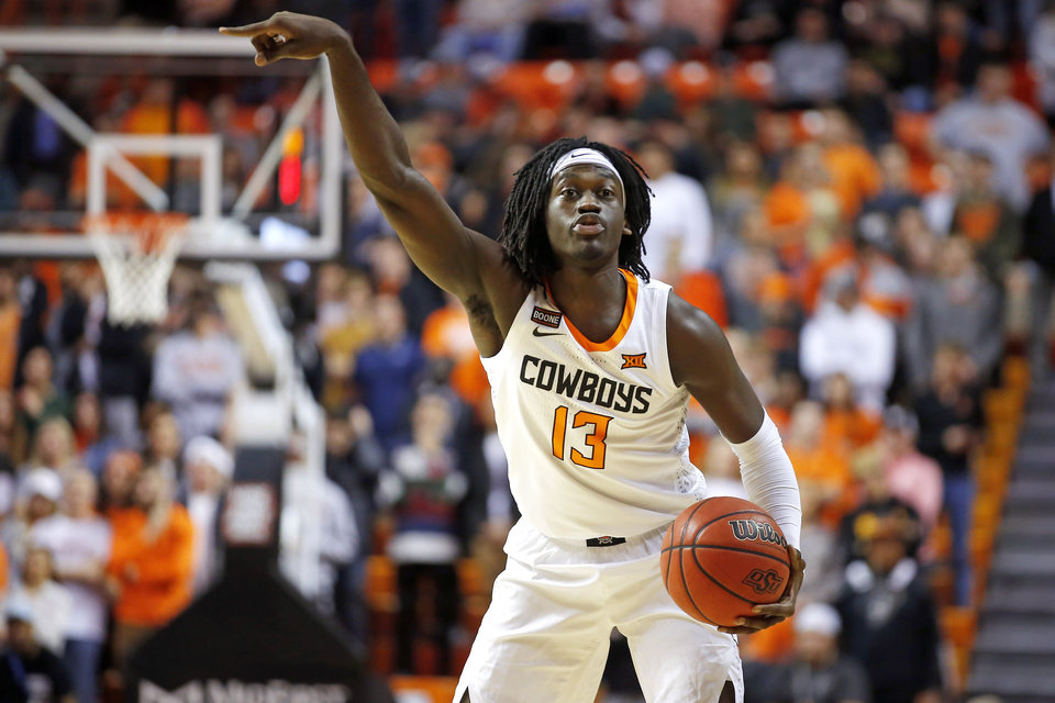 Photo - Oklahoma State's Isaac Likekele (13) gestures during an NCAA basketball game between the Oklahoma State University Cowboys (OSU) and the Texas Longhorns at Gallagher-Iba Arena in Stillwater, Okla., Wednesday, Jan. 15, 2020. Oklahoma State lost 76-64. [Bryan Terry/The Oklahoman]