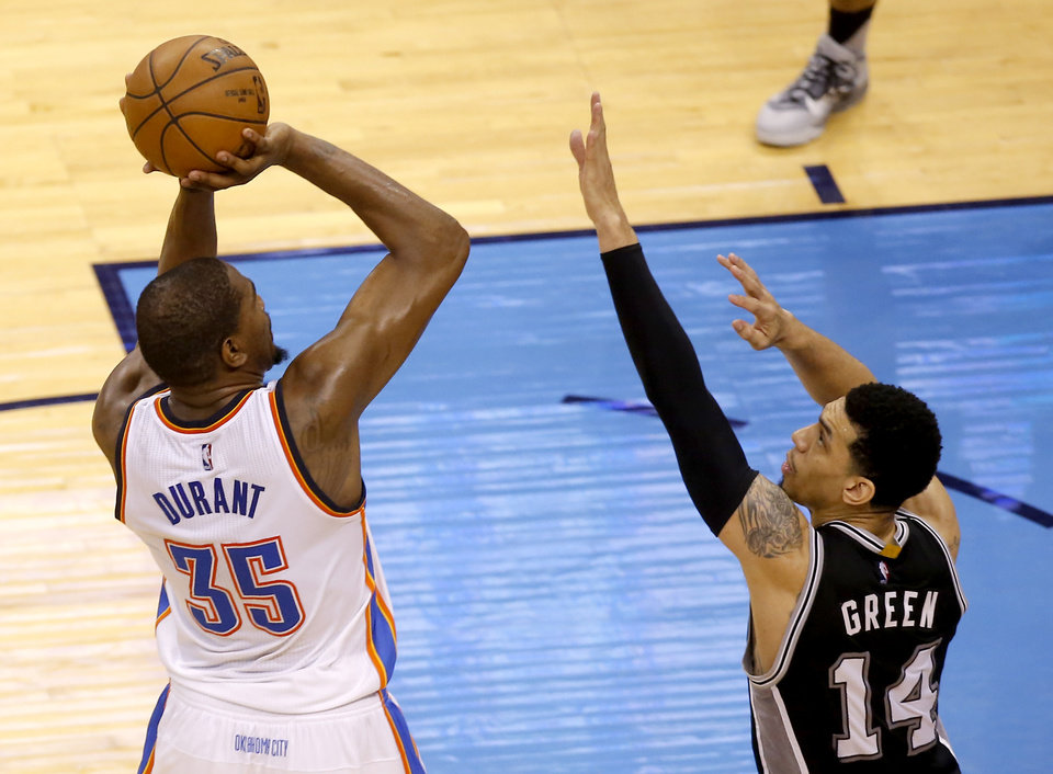 Photo - Oklahoma City's Kevin Durant (35) shoots over San Antonio's Danny Green (14) during Game 4 of the Western Conference semifinals between the Oklahoma City Thunder and the San Antonio Spurs in the NBA playoffs at Chesapeake Energy Arena in Oklahoma City, Sunday, May 8, 2016. Photo by Sarah Phipps, The Oklahoman