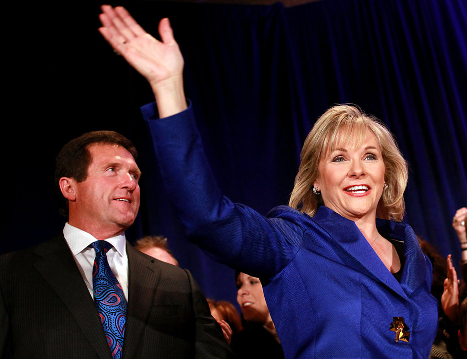 Photo - Governor elect of Oklahoma Mary Fallin and her husband Wade Christensen greet supporters as they take the stage during the Republican Watch Party at the Marriott in Oklahoma City on Tuesday, Nov. 2, 2010.Photo by John Clanton, The Oklahoman