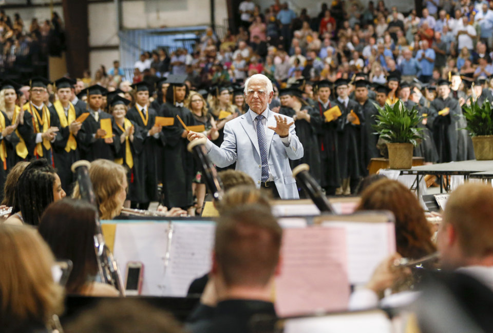 Photo -  George Nigh directs the McAlester High School band in