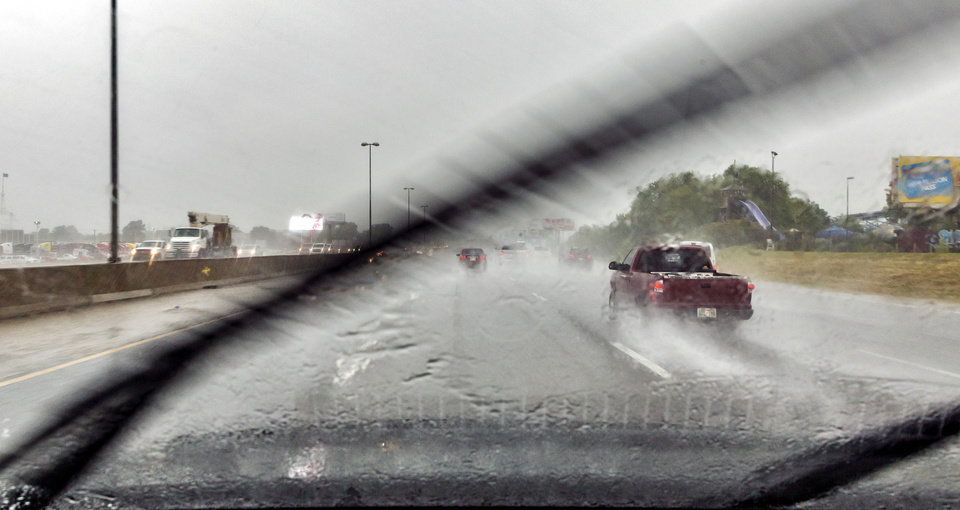 Photo - Traffic makes its way down I-40 through heavy rains in Oklahoma City, Okla. on Thursday, June 6, 2019. [Chris Landsberger/The Oklahoman]