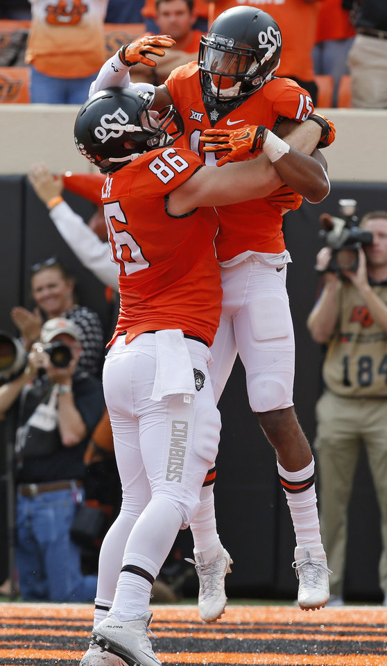 Photo -  Oklahoma State receiver Chris Lacy (right) celebrates a touchdown with Zac Veatch last week against West Virginia. Lacy had his best game as a Cowboy. [PHOTO BY NATE BILLINGS, THE OKLAHOMAN]