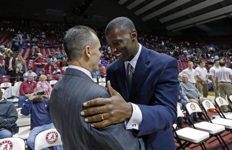 Photo -  Billy Donovan, left, and Anthony Grant talk before coaching against each other Jan. 23, 2014 in Tuscaloosa, Ala. Donovan's Florida Gators beat Grant's Alabama Crimson Tide 68-62. [AP Photo/Michelle Lepianka Carter]