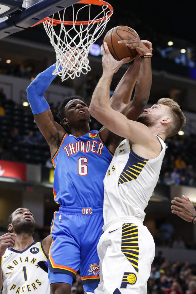 Photo - Indiana Pacers forward Domantas Sabonis (11) and Oklahoma City Thunder guard Hamidou Diallo (6) fight for a rebound during the first half of an NBA basketball game in Indianapolis, Tuesday, Nov. 12, 2019. (AP Photo/Michael Conroy)