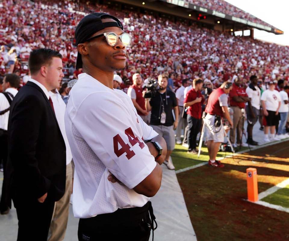 Photo - Oklahoma City Thunder player Russell Westbrook attends a college football game between the University of Oklahoma Sooners (OU) and Louisiana-Monroe (ULM) Warhawks at Gaylord Family-Oklahoma Memorial Stadium in Norman, Okla., on Saturday, Sept. 10, 2016. Photo by Steve Sisney, The Oklahoman