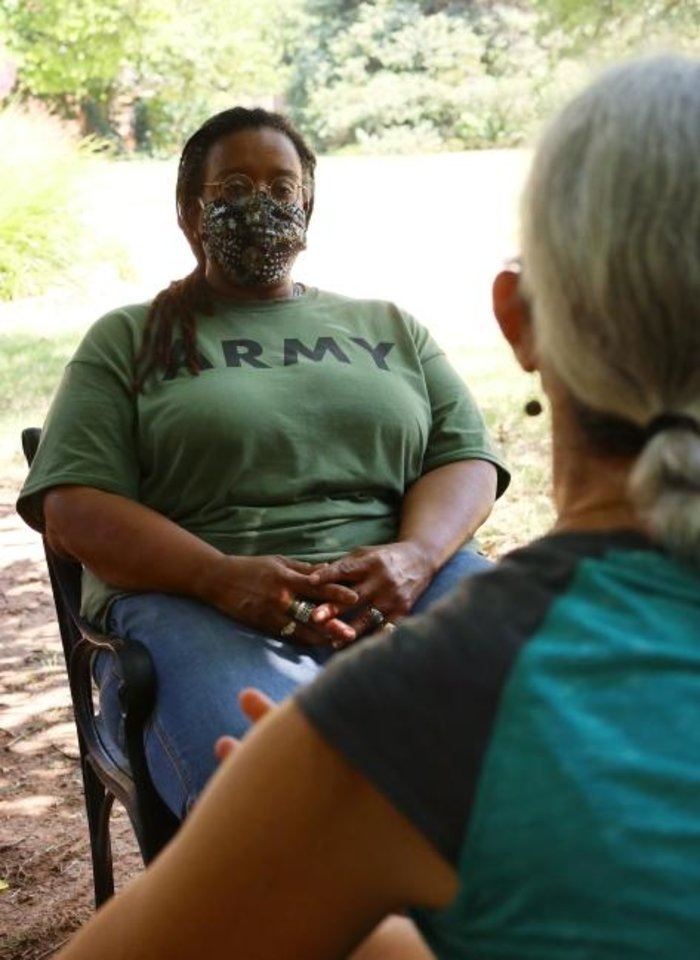 Photo -  The Rev. E. Ann Gaines Ali chats with her friend Terry Fife at Fife's home. [Doug Hoke/The Oklahoman]