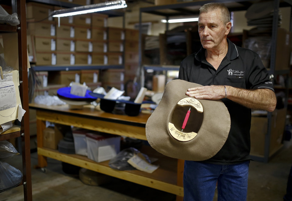 Larry Brandon works on shaping the a custom cowboy hat at Shorty s Caboy  Hattery in the a79313446d4