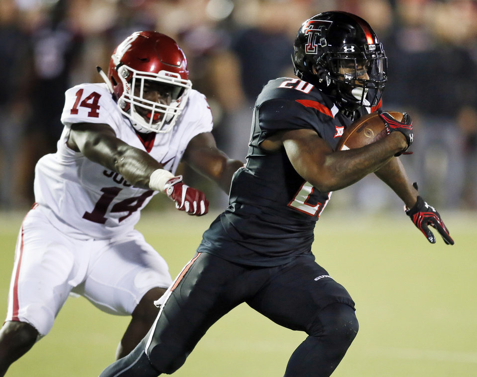 Photo - Texas Tech's Keke Coutee (20) runs from Oklahoma's Emmanuel Beal (14) after a catch in the second quarter during a college football game between the University of Oklahoma Sooners (OU) and Texas Tech Red Raiders at Jones AT&T Stadium in Lubbock, Texas, Saturday, Oct. 22, 2016. Photo by Nate Billings, The Oklahoman