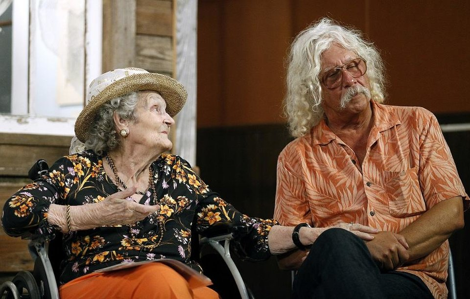 Photo - Woody Guthrie's sister Mary Jo Guthrie Edgmon, 91, and son Arlo Guthrie tell stories about Woody during the 2014 Woody Guthrie Festival in Okemah, Okla., Friday, July 11, 2014. Photo by Sarah Phipps, The Oklahoman Archives