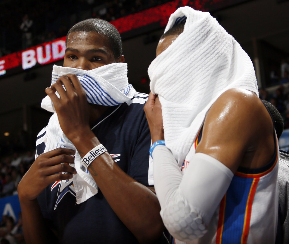 Photo - Oklahoma City's Kevin Durant (35), left, and Russell Westbrook (0) talk to each other in the bench area during the fourth quarter of an NBA basketball game between the Oklahoma City Thunder and Minnesota Timberwolves at Chesapeake Energy Arena in Oklahoma City, Friday, Feb. 22, 2013. Oklahoma City won, 127-111. Photo by Nate Billings, The Oklahoman