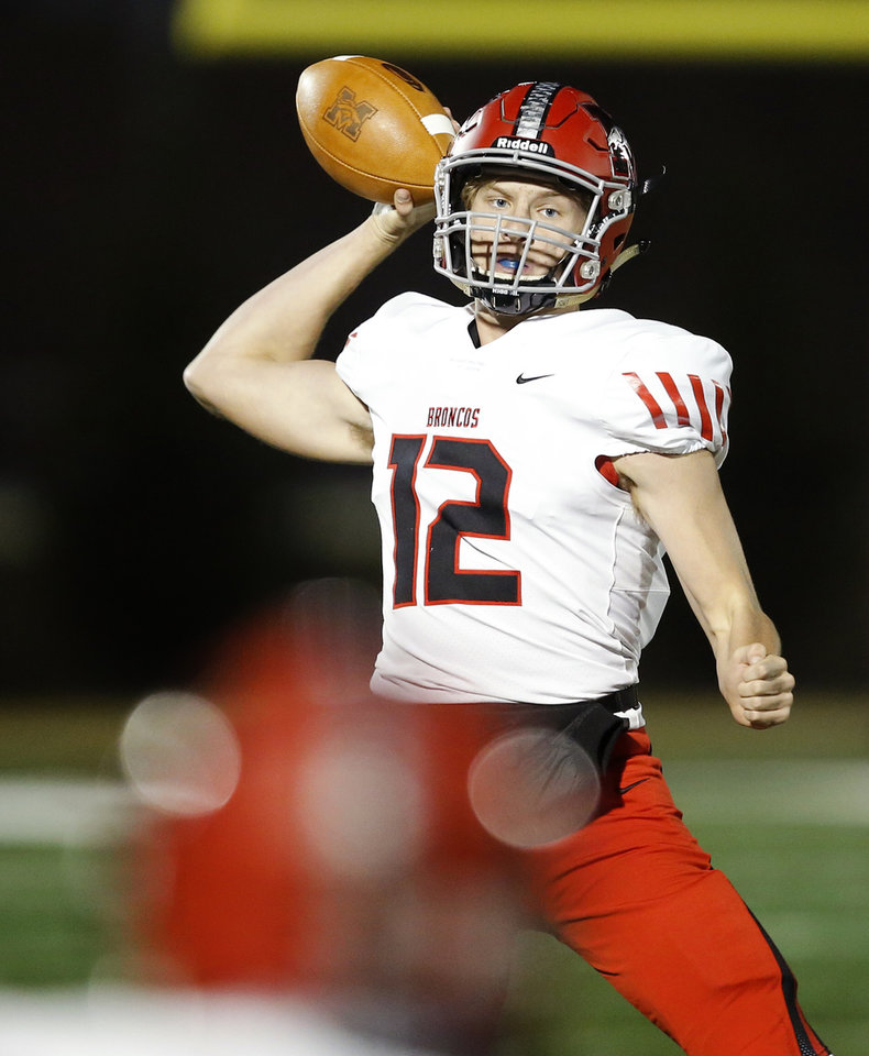 Photo - Mustang's Hayden Conrad throws a pass during a high school football game between Putnam City North and Mustang in Oklahoma City, Friday, Nov. 1, 2019.  [Bryan Terry/The Oklahoman]