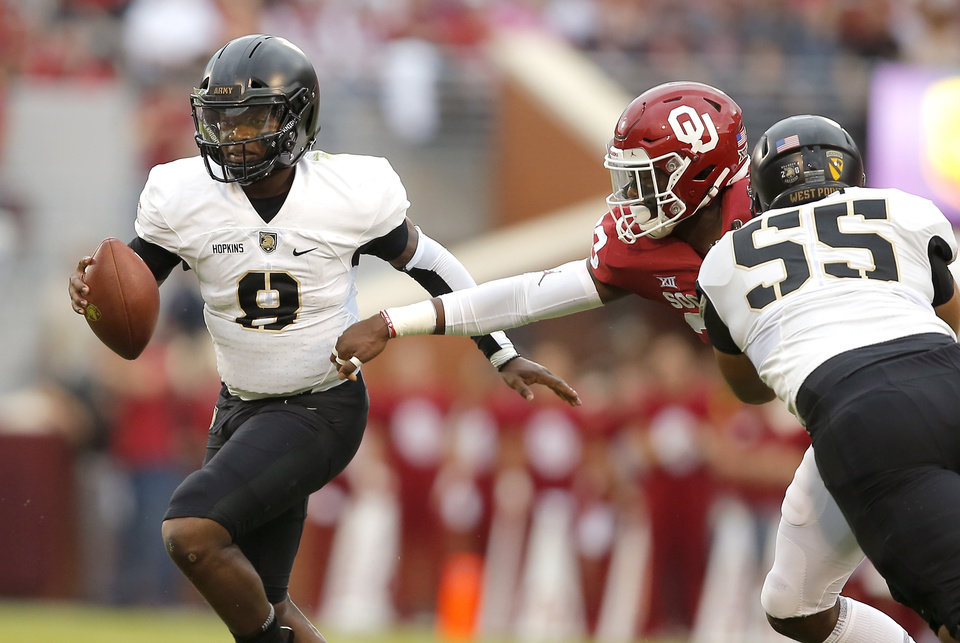 Photo - Army's Kelvin Hopkins Jr. (8) runs past Oklahoma's Ryan Jones (33) during a college football game between the University of Oklahoma Sooners (OU) and the Army Black Knights at Gaylord Family-Oklahoma Memorial Stadium in Norman, Okla., Saturday, Sept. 22, 2018. Photo by Bryan Terry, The Oklahoman
