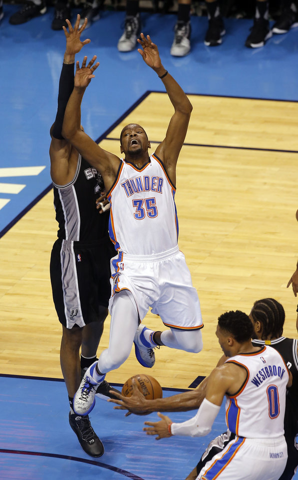 Photo - Oklahoma City's Kevin Durant (35) reacts after losing the ball as David West (30) defends during Game 4 of the Western Conference semifinals between the Oklahoma City Thunder and the San Antonio Spurs in the NBA playoffs at Chesapeake Energy Arena in Oklahoma City, Sunday, May 8, 2016. Photo by Sarah Phipps, The Oklahoman