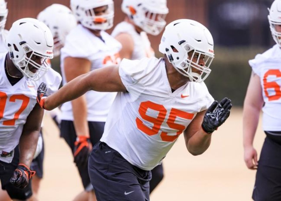 Photo - Oklahoma State defensive lineman Israel Antwine (95) is meshing with his new teammates quickly this spring. [CHRIS LANDSBERGER/THE OKLAHOMAN]