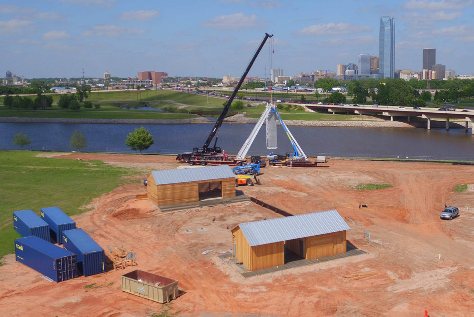 Photo -  The future food truck plaza and shipping containers that will be used to create a wind screen are components in a plaza that is being constructed around a Ferris wheel being built at Wheeler along the south shore of the Oklahoma River. [Photo by Stephen Tyler, For The Oklahoman]