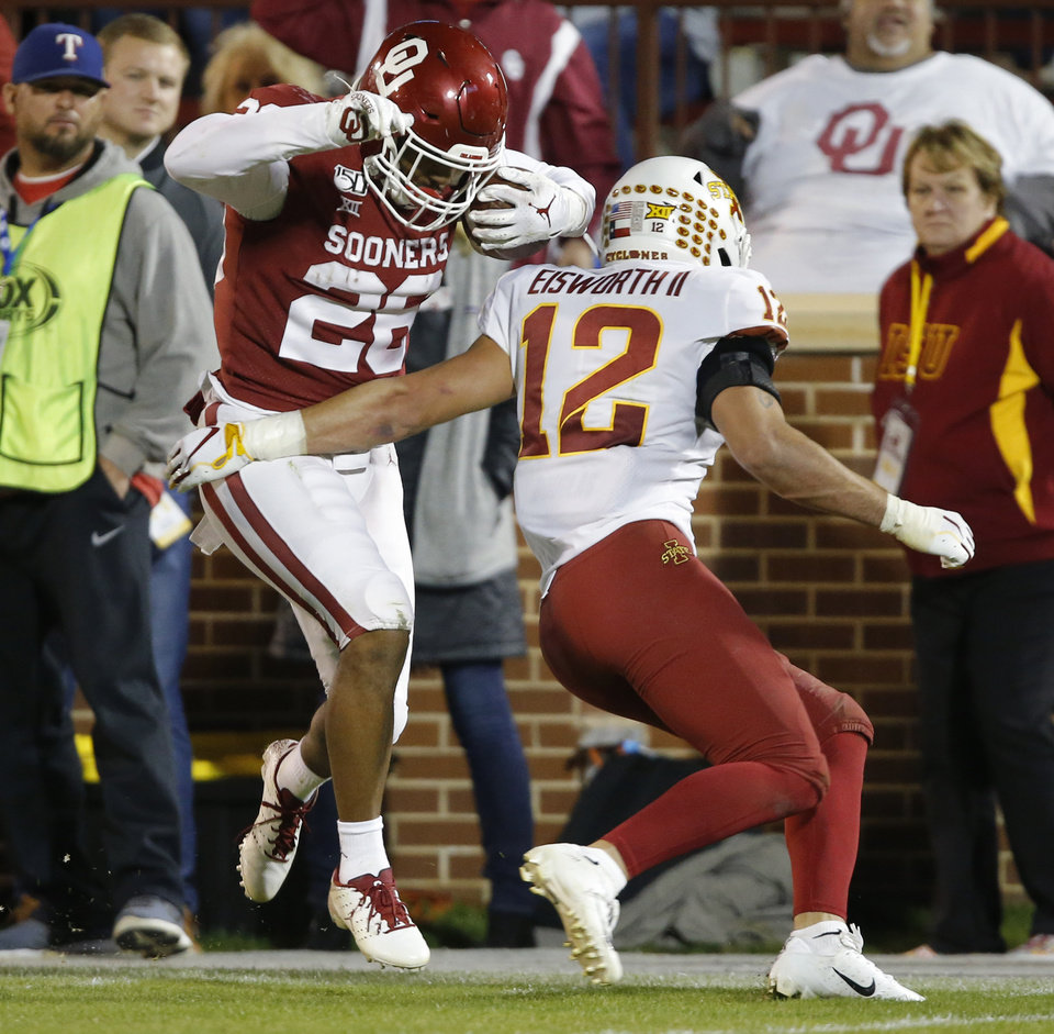 Photo - Oklahoma's Kennedy Brooks (26) gets past Iowa State's Greg Eisworth (12) on his way to the end zone during an NCAA football game between the University of Oklahoma Sooners (OU) and the Iowa State University Cyclones at Gaylord Family-Oklahoma Memorial Stadium in Norman, Okla., Saturday, Nov. 9, 2019. [Bryan Terry/The Oklahoman]