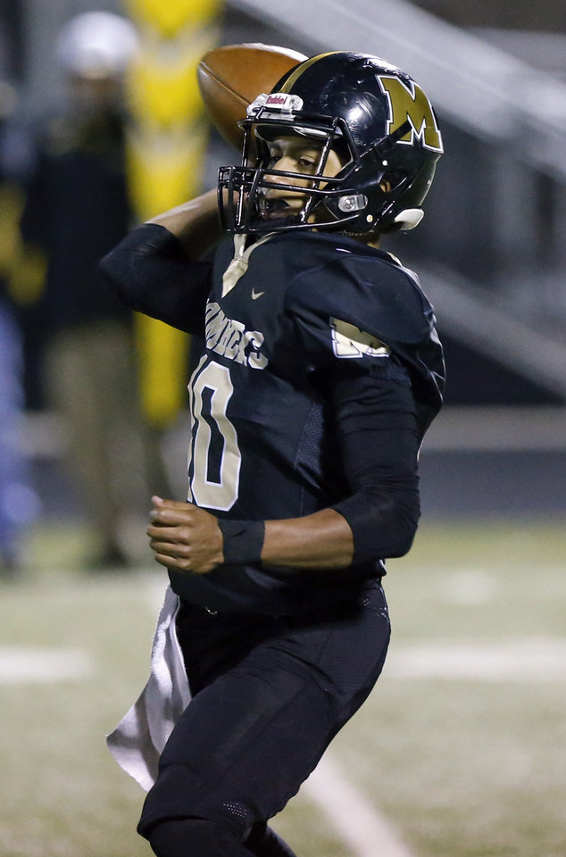 Photo - Midwest City's DeAngelo Irvin Jr. (10) passes during a high school football game between Midwest City and Choctaw at Rose Field in Midwest City, Okla., Friday, Nov. 1, 2019. [Nate Billings/The Oklahoman]