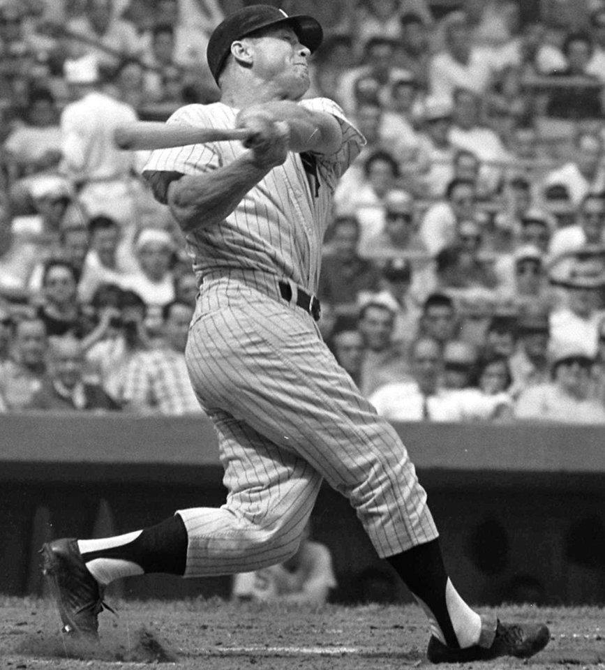 Photo - Mickey Mantle, shown in this 1961 file photo, whose mammoth swing and country-boy charm made him a larger-than-life hero to generations of fans.