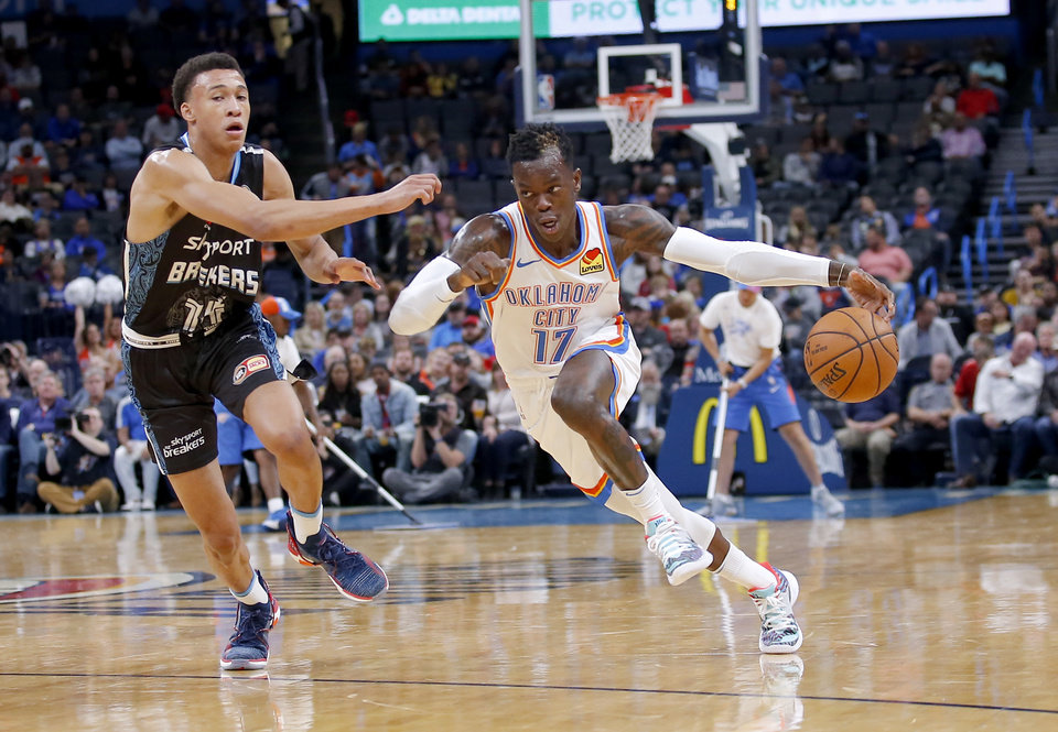 Photo - Oklahoma City's Dennis Schroder (17) drives up court at New Zealand Breakers' R.J. Hampton (14) defends during the NBA preseason game between the Oklahoma City Thunder and the New Zealand Breakers at the Chesapeake Energy , Thursday, Oct. 10, 2019. [Sarah Phipps/The Oklahoman]