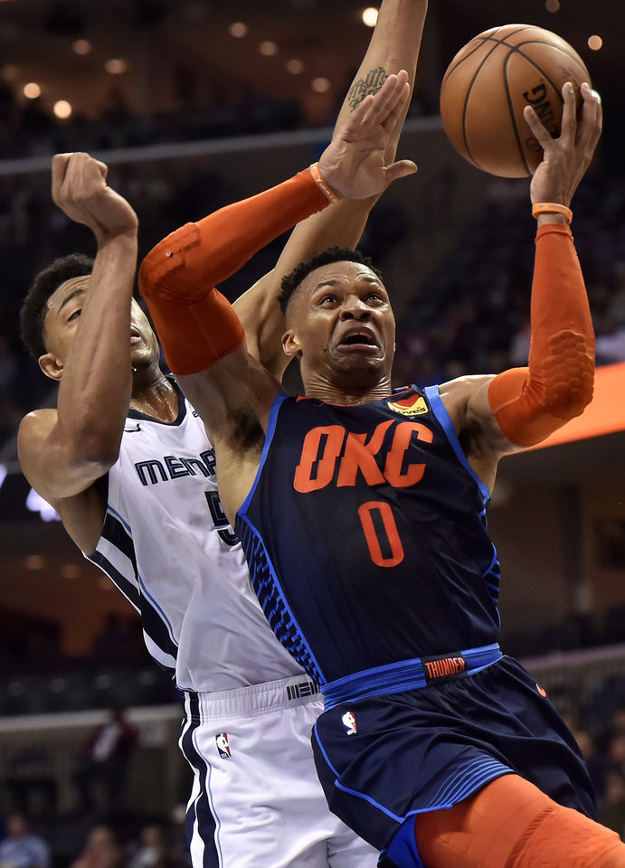 Photo - Oklahoma City Thunder guard Russell Westbrook (0) shoots in front of Memphis Grizzlies forward Bruno Caboclo during the second half of an NBA basketball game Monday, March 25, 2019, in Memphis, Tenn. (AP Photo/Brandon Dill)